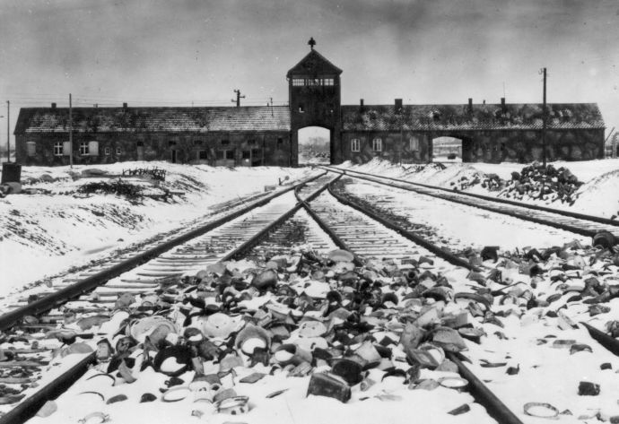 "An undated archive photograph shows Auschwitz II-Birkenau main guard house which prisoners called ""the gate of death"". An undated archive photograph shows Auschwitz II-Birkenau's main guard house which prisoners called ""the gate of death"" and the railway with the remains of abandoned crockery. The railway, which was built in 1944, was the last stop for the trains bringing Jews to the death camp. REUTERS/HO-AUSCHWITZ MUSEUM"